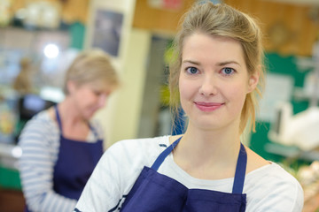 beautiful happy young woman in apron