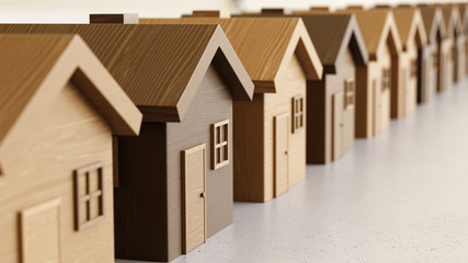 Linear Array of Toy Wooden Houses on a Light Gray Surface