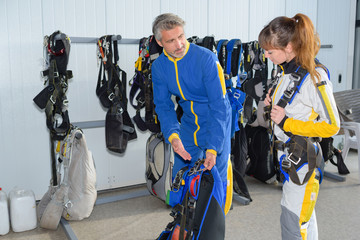 skydiving monitor and student preparing in the hangar