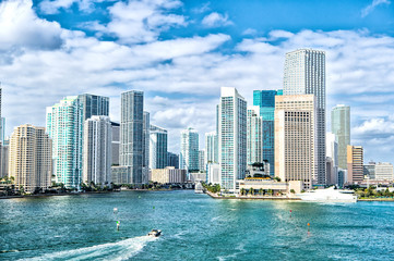 Aluminium Prints American Famous Place miami skyline. Yachts sail on sea water to city