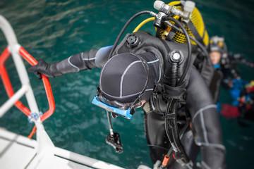 Scuba diver getting on board