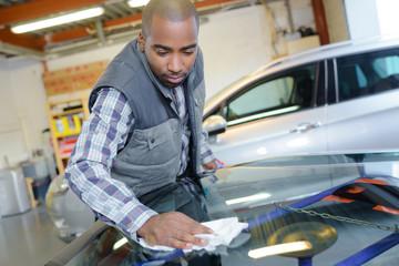 automotive glass mechanic working