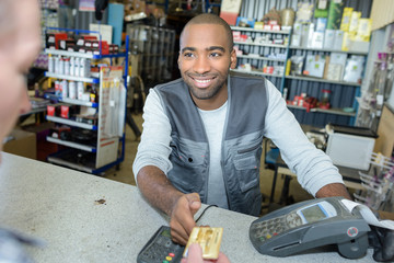 Man accepting card payment from customer