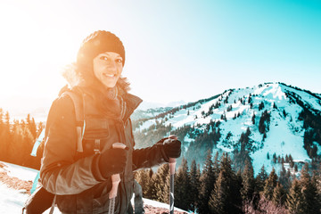 Fotomurales - Young smiling woman hiking in winter mountains