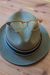 Hipster hat with horn rimmed glasses on top, modern concept, vertical aspect