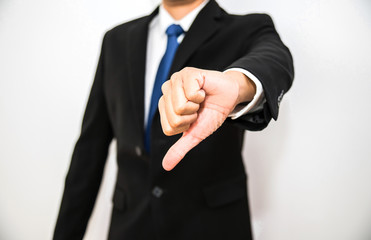 Business man giving thumbs down for bad isolated on white background