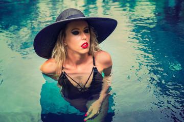 Fashionable woman in pool