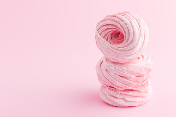 Homemade pink zephyr or marshmallow on pink background