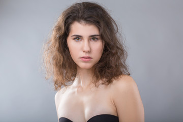 Beauty portrait of young adorable fresh looking brunette woman with brown hair. Emotion and facial expression concept.