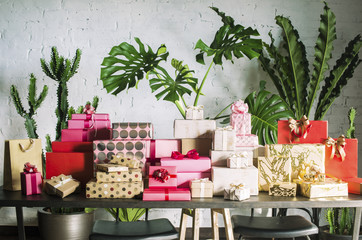 Stacks of colorful gift boxes on a table.