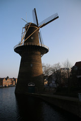 Windmill along river Schie in the city of Schiedam, The Netherlands