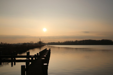 Sunset over the river rotte and waterstorage of the Eendragtspolder in Zevenhuizen, Netherlands
