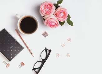Pink roses, coffee and small gold objects