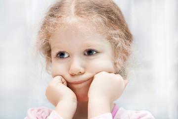 Little sad curly girl portrait.