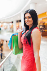 Beautiful woman with shopping bags at the mall