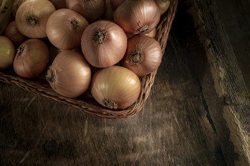 Onions on Vintage Wood Table Background, Rustic Style.