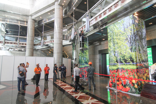 Forensic police conduct an inspection of a mezzanine, similiar to the one which collapsed yesterday, in the main lobby of Indonesia Stock Exchange (IDX) building in Jakarta