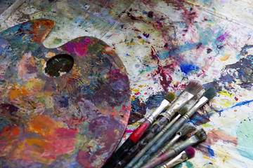 workplace painter palette with colors and brushes. Palette of colors, creative disorder, art