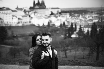 Loving young couple walking around Prague, Czech Republic