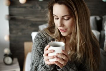 Attractive woman drinking morning coffee