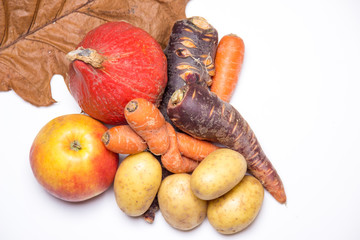 Pumpkin, potatoes, carrots, apple, leaves (autumn harvest)