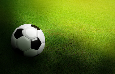 3D Rendered black and white soccer ball on green soccer football field background