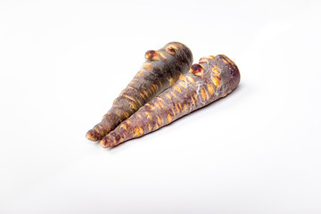 a violet carrot mirrored on white background