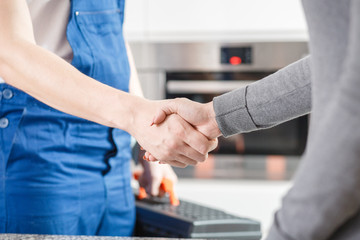 Specialist shaking hands with housewife