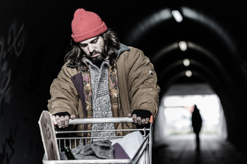 Hopeless drifter with trolley