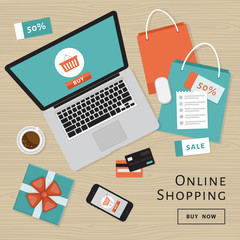 Online shopping concept. Online store objects and banner. Table with laptop, shopping bags, credit cards, gifts and coupons. Flat style, vector illustration.