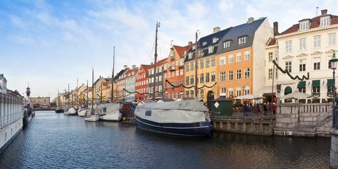Panoramic view of the Nyhavn (new harbor) during the Christmas holidays with christmas ornament. (Europe - Denmark)