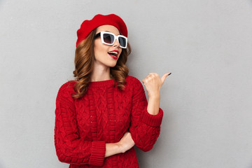 Portrait of a happy woman dressed in red sweater