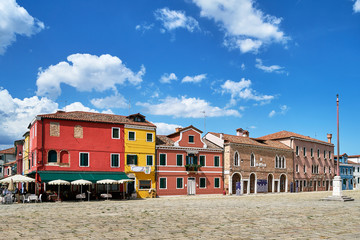 Burano, Venice. Old colorful houses architecture at the square. Summer 2017, Italy