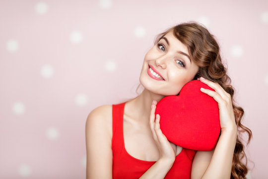 woman with red hearts on pink background.