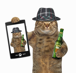 The cat holds a bottle of beer and a smartphone. White background.