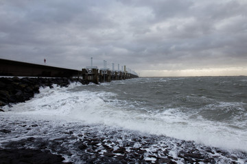 Storm surge barrier Eastern Scheldt dam closed for high sea level in storm