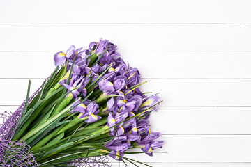 Iris bouquet on white wooden background. Bouquet. Copy space, top view.