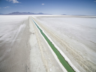 High angle view of salt flat against blue sky
