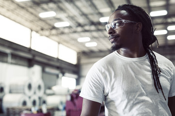 Thoughtful blue collar worker wearing protective eyeglasses in steel industry