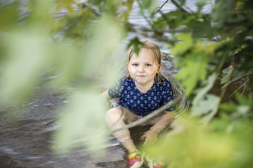 High angle portrait of girl sitting in lake