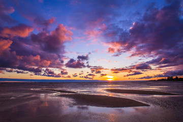 Violet clouds. Smelling on the sea. Sandy islands. Sunset over the sea.