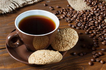 Brown pot, grains and oatmeal cookies on a wooden background