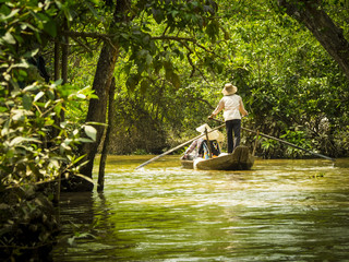 Tourists in a boat in Mekong delta