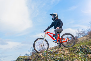 Cyclist on the mountain bike, free space for your text.