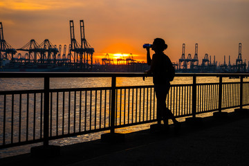 Silhouette of woman drinking at Labrador Park