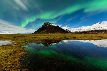 Northern light in Iceland an amazing paradise. Spectacular aurora borealis near the glacier lagoon Jokulsarlon. Beautiful nightscape.