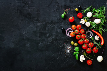 Fresh vegetables, herbs, onion, mushrooms, basil and spices on black background. Copy space