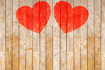 Red Hearts painted on wooden background
