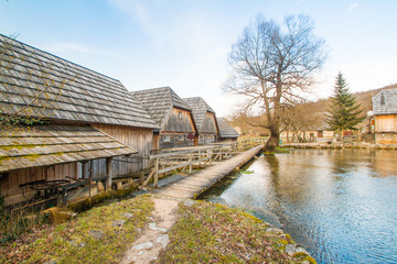 Old wooden water mills on Majerovo vrilo, countryside landscape in Lika, Croatia
