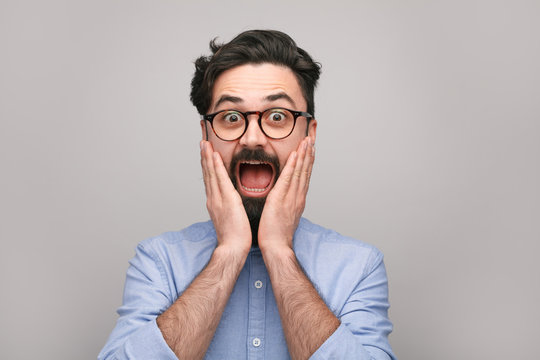 Surprised man in glasses
